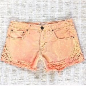 Free People distressed laced denim shorts in peach